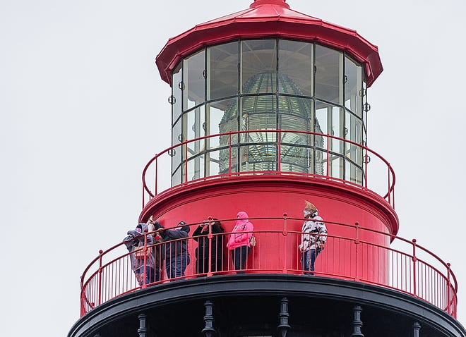 Visitors to the top of St. Augustine's lighthouse spend a cold and windy Monday, Feb. 1, 2021, looking out over the city.