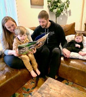 "HGTV's ""Good Bones"" star Mina Starsiak-Hawk with her husband, Steve, reads her new children's book to son, Jack, 2, as daughter, Charlie, four-months, listens in. (Photo courtesy of Starsiak-Hawk)"