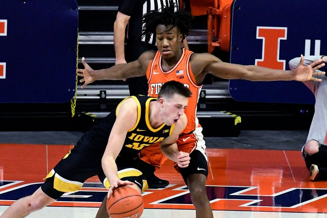 Illinois guard Ayo Dosunmu defends against Iowa guard Joe Wieskamp during the second half Friday in Champaign. (AP Photo/Holly Hart)