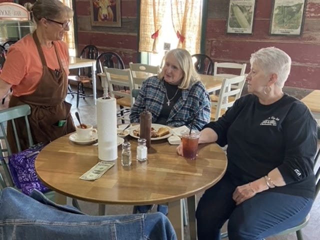 Debbie Burkhart talks with customers Jane Smith and Dianna Horath.
