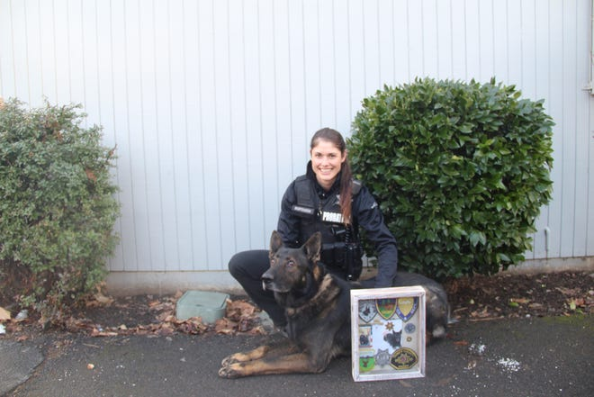 Roo and his handler and owner  Charmain Mortenson in front of the Siskiyou County Probation Department on Friday.