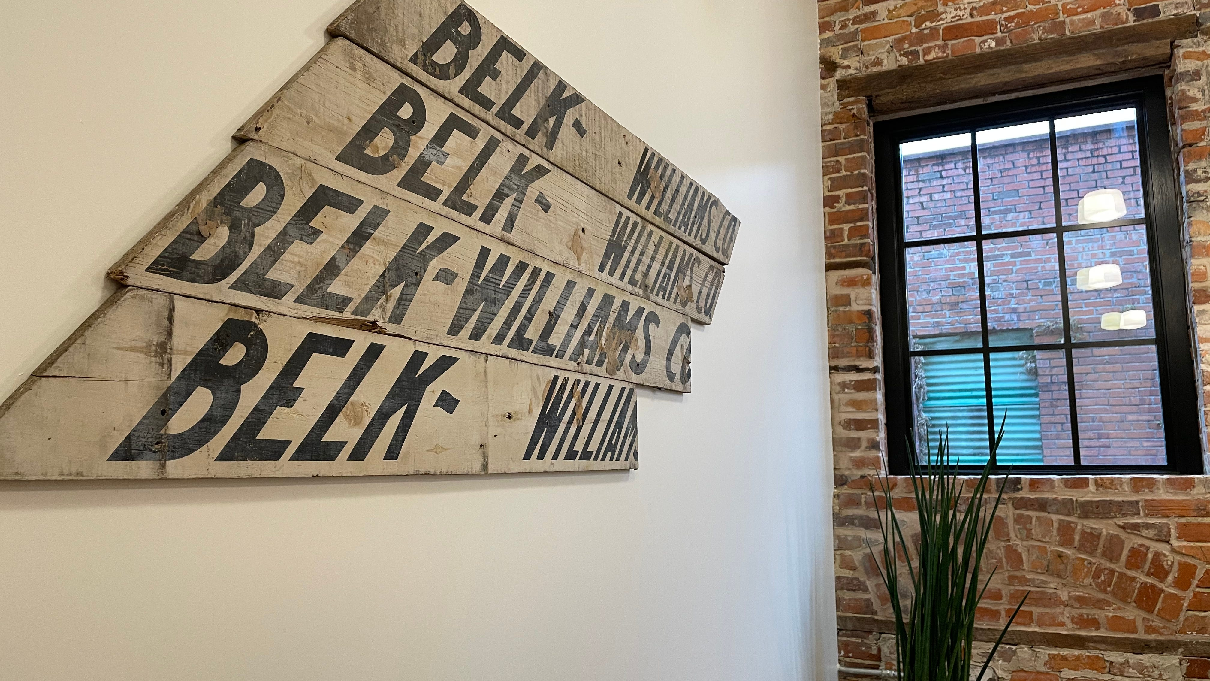 A recovered piece of signage from the Gaylord building's years as the home of the Belk-Williams department store hangs on the second floor of the renovated space.