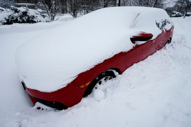 FILE - A car is covered by snow in Wheeling, Ill., Sunday, Jan. 31, 2021. [AP Photo/Nam Y. Huh]