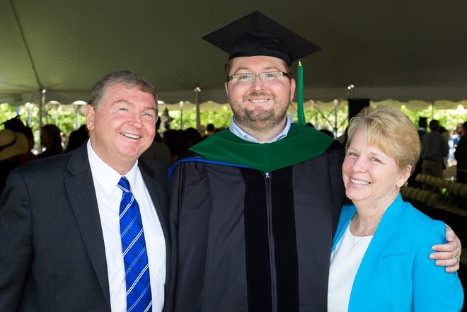 Dr. Robert James 'Bobby' Ross, center, celebrates with his parents, Jim Ross, left, and Pam Ross, right, at the May 2016 Doctor of Medicine (MD) commencement ceremony at Yale University. [CONTRIBUTED PHOTO]