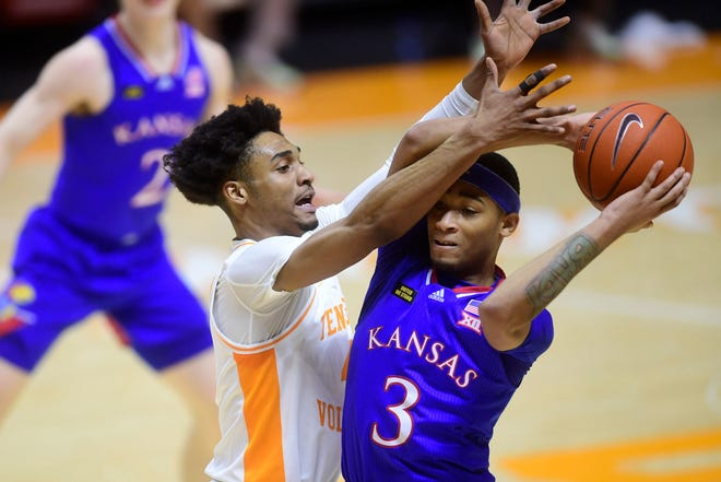 Kansas guard Dajuan Harris attempts to make a pass while Tennessee guard Keon Johnson defends during Saturday's game at Thompson-Boling Arena in Knoxville, Tenn. The Jayhawks lost 80-61 and have now dropped four of their last five contests.