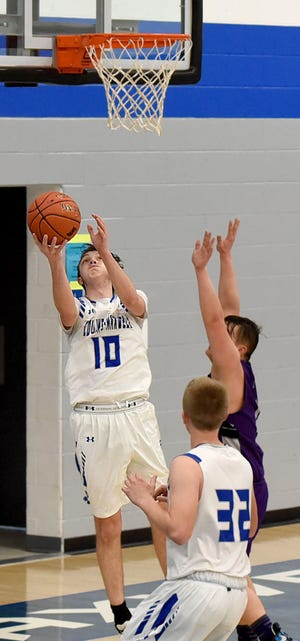 Collins-Maxwell's Austin Kepple goes up for a reverse layup during the Spartans' 71-24 victory over Valley Lutheran Friday at Maxwell.