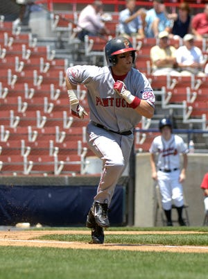 Dustin Pedroia, on a day he played third base for the Pawtucket Red Sox in 2006, charges down the first base line after making contact against the host Richmond Braves.