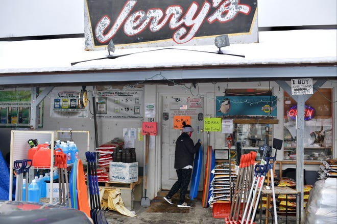 A customer sorts through the sleds at Jerry's Hardware on West Boylston Street in Worcester. The store was busy Monday morning -  well-stocked with snow supplies.