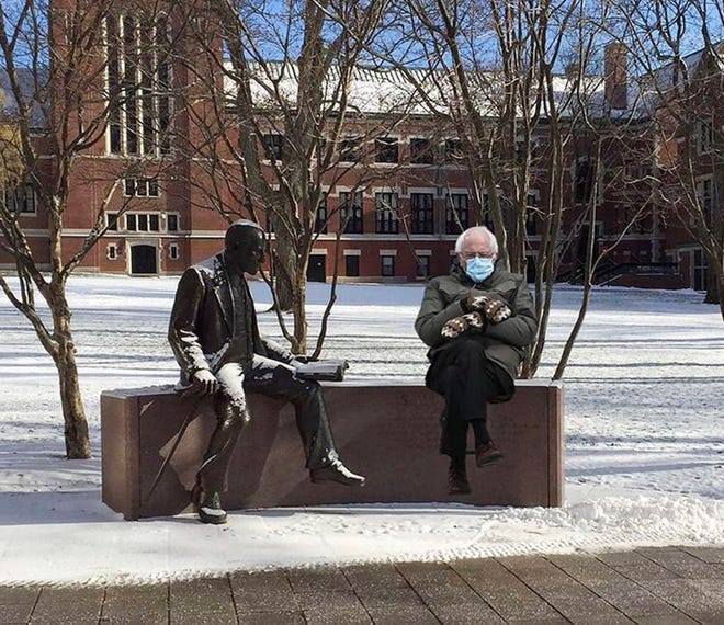 Clark University Professor Hugh Manon created and posted a meme of Bernie sitting next to a statue of Sigmund Freud in the center of the Clark campus.