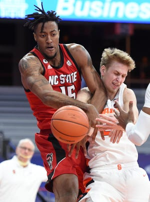 Fayetteville native Manny Bates (15) finished with 17 points and a career-high 14 rebounds for the second double-double of his career in NC State's loss at Syracuse.