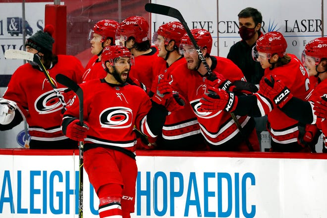 Carolina Hurricanes' Vincent Trocheck (16) celebrates his goal with teammates during the shootout of an NHL hockey game against the Dallas Stars in Raleigh, N.C., Sunday, Jan. 31, 2021. (AP Photo/Karl B DeBlaker)