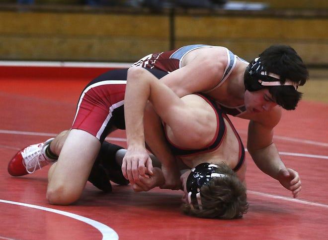 Dover's Egidio DiFazio battles New Philadelphia's Thad VanArsdalen in a match last Saturday.
