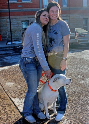 Kaetlin Taylor (left) hugs her best friend Rebecca Wold the day after Wold rescued her and her dog Pippin from the icy waters of Brush Hollow Reservoir.