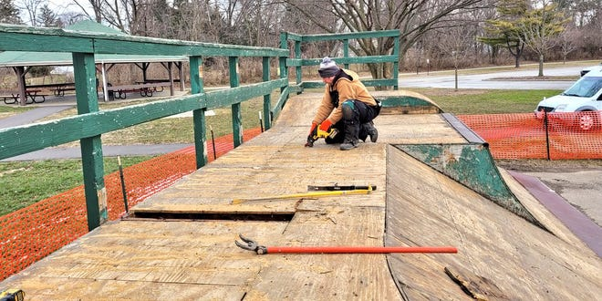 Jason Douglas, assistant parks maintenance supervisor, removes a portion of the plywood framing at the skatepark at John F. Kennedy Park as part of the $24,000 improvement project.