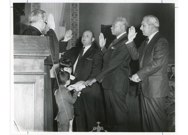 Municipal Judge Alan Schwarzwalder (left) swears in Donald Woodland, Dr. John Rosemond and Maurice Portman to Columbus City Council in January 1970. Woodland and Portman were incumbents, and Rosemond was newly elected. Rosemond was the first Black man to run for and win a seat on council. He served three terms and was Columbus' first Black mayoral candidate in 1975.