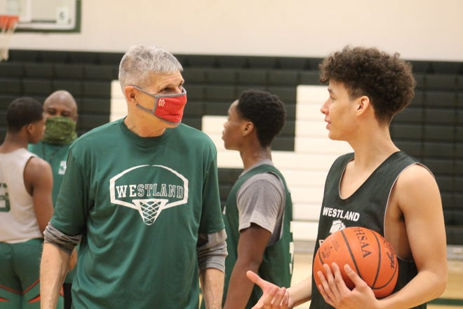 Former Ready and Denison coach Bob Ghiloni instructs Westland freshman Gristian Perez during the boys basketball team's practice Jan. 30. Ghiloni is in his first season as a volunteer assistant coach with the Cougars.