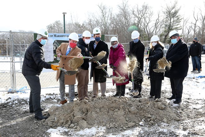 Selectman Chris Rohland, State Senator Patrick O'Connor, State Representative Patrick Kearney, selectman Stephen Darcy, building committee co-chair Sheila Gagnon, building committee co-chair Bill Scott, COA director Carol Hamilton, and town administrator Michael Maresco partake in the ceremonial groundbreaking of the new addition at the senior center on Friday, Jan. 29, 2021.