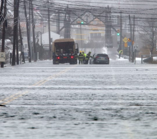 Manasquan firefighters in a high water vehicle check on the occupants of a car that got stuck in flood waters along Brielle Road in the borough Monday morning, February 1, 2021.