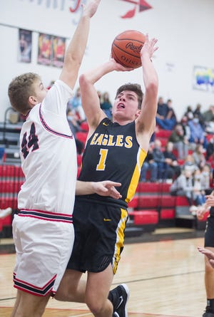 Colonel Crawford's Mason Studer puts up a shot over Mohawk's Reese Hannam.