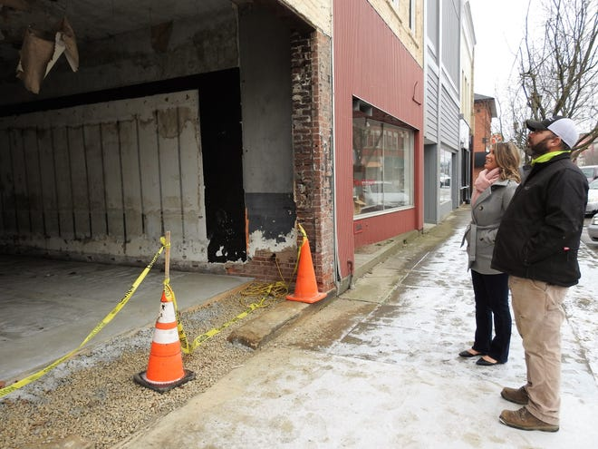 Carly and Jason Thompson review the outside of two buildings in the 500 block of Main Street they are renovating and should have completed this summer. The goal is to have the ground floor be two storefronts and the upstairs will go from being apartments to an annex of the Thompson Business Center.