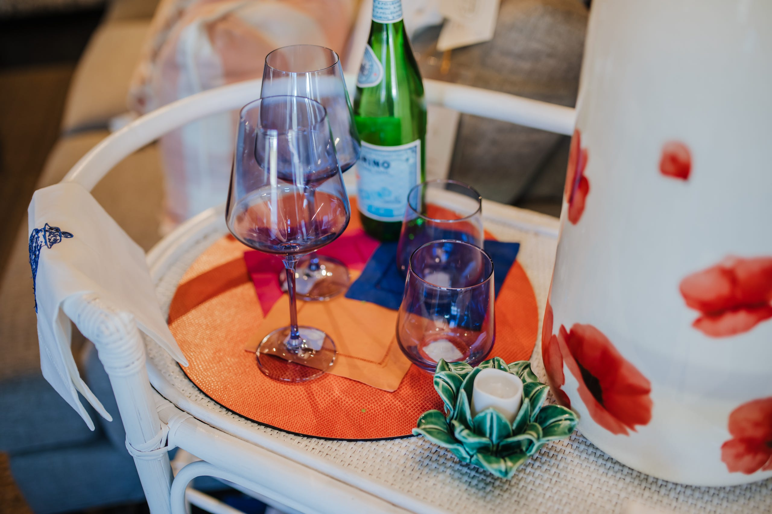 Brightly hued drinking glasses, bottles, decanters and cake stands of today are elegant, delicate and fun.