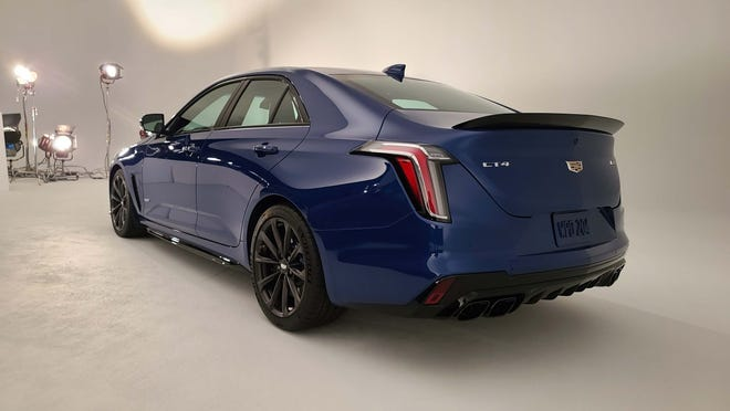 Cadillac CT4 V-Series Blackwing rear features quad pipes and diffuser for downforce.