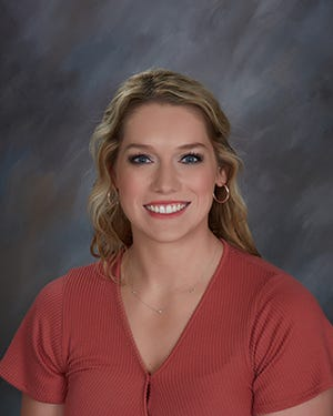 Madison Aiton named Memorial volleyball coach