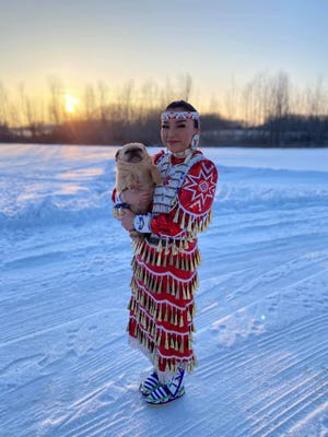 Shundiin Whitehorse, 16, won second place in the Social Distance Powwow's red jingle dress contest.