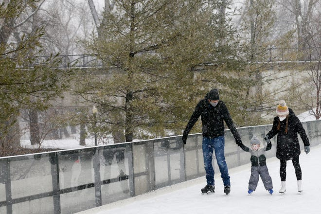Brian and Kelly McPhail of Lafayette, help their son, Andrew, 3, skate around the rink at Riverside Skating Center, Sunday, Jan. 31, 2021 in West Lafayette.