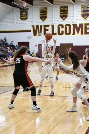 Berne Union senior Emily Blevins passes the ball into Sophia Kline during the Rockets' 49-44 overtime win over Alexander. On Sunday, the Rockets were awarded the No. 1 seed in the Central District Division IV tournament draw.
