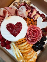 Hearts and roses on a food board by Cheers Cheese Board in Tenafly