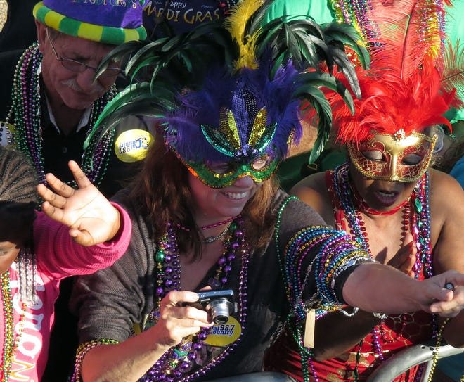 Colorful outfits are featured in this 2013 Mardi Gras Parade in Pensacola, Florida.