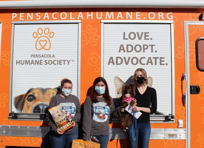 Central Credit Union of Florida raises funds with Giving Trees to donate to local charities (Pensacola Humane Society).
