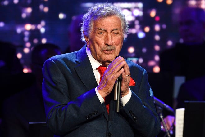 """FILE - Singer Tony Bennett performs at the Statue of Liberty Museum opening celebration in New York on May 15, 2019. Bennett has been diagnosed with Alzheimer's disease but the diagnosis hasn't quieted his legendary voice. The singer's wife and son reveal in the latest edition of AARP The Magazine that Bennett was first diagnosed in 2016. The magazine says he endures """"increasingly rarer moments of clarity and awareness."""" (Photo by Evan Agostini/Invision/AP, File)"""