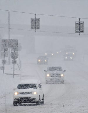 Snowfall increases by mid afternoon on Route 30 near North George Street during a winter storm in Manchester Township, Monday, Feb. 1, 2021. Dawn J. Sagert photo