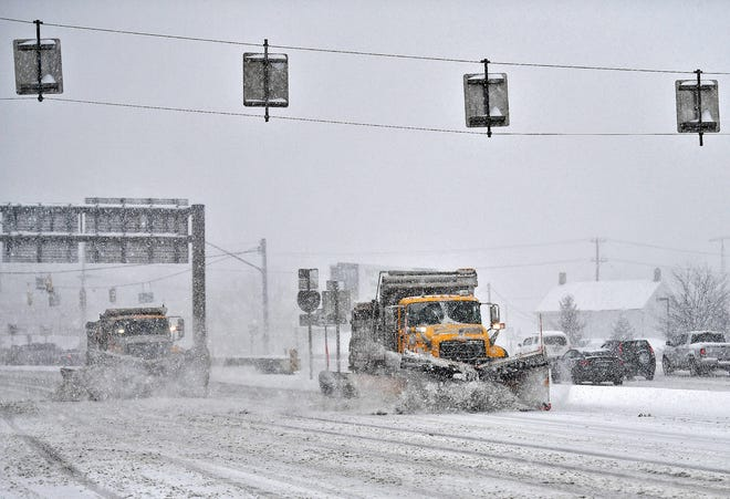 A pair of snow plows work as snowfall increases along Route 30 near North George Street during a winter storm in Manchester Township, Monday, Feb. 1, 2021. Dawn J. Sagert photo