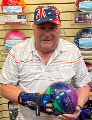 Frank Ferreira is photographed in the pro shop in Mesquite. Ferreira is one of 12 local bowlers to have rolled a 300 game.