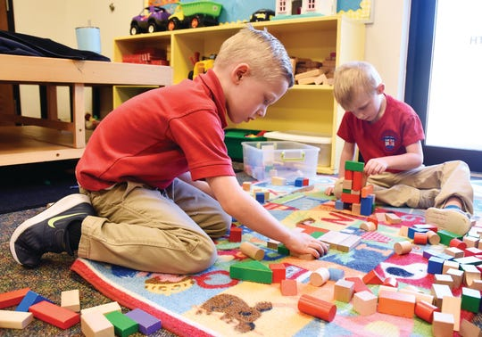 Children participate in classroom activities at Spartanburg Christian Academy.