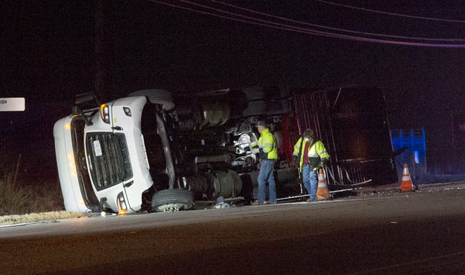 Emergency crews work to clean up a rollover accident Monday morning on Seymour Highway west of Wichita Falls.