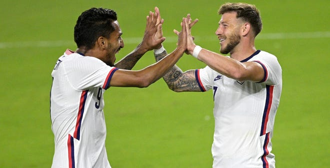Jesus Ferreira (left) and Paul Arriola celebrate after Arriola scored a goal during the first half.