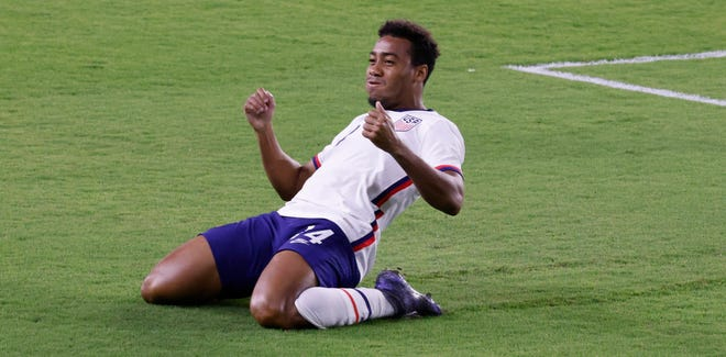 Jonathan Lewis celebrates after scoring a goal against Trinidad and Tobago.