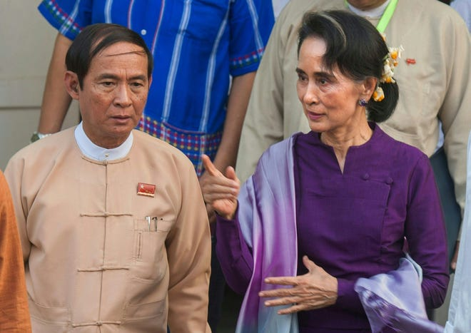 Aung San Suu Kyi, right, is accompanied Win Myint, Myanmar's president, in March 14, 2016.
