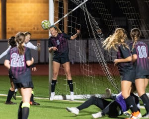 Round Rock's Makky Thinger heads the ball away from the Round Rock goal after a Vandegrift corner kick. Round Rock won a girls district soccer match 1-0 at home over Vandegrift on Friday.