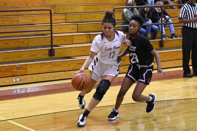 Bastrop's Sierra Brown makes a move past a Rouse defender.