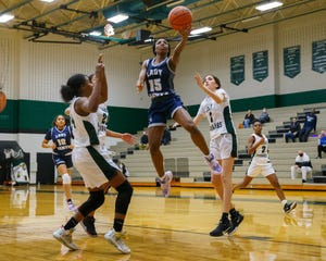 Hendrickson guard Makayla Ward scores a basket against the Connally Cougars during the fourth period at the District 18-5A girls basketball game on Feb. 1 at Connally High School.
