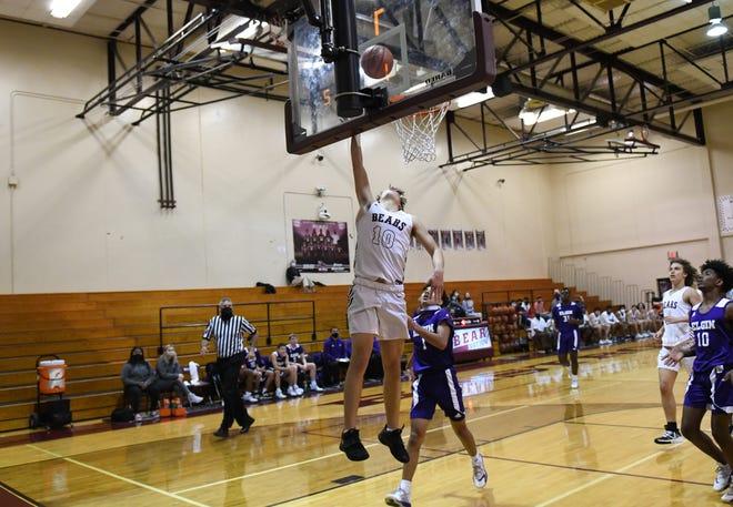 Bastrop's James Ramon (10) makes a move toward the basket.