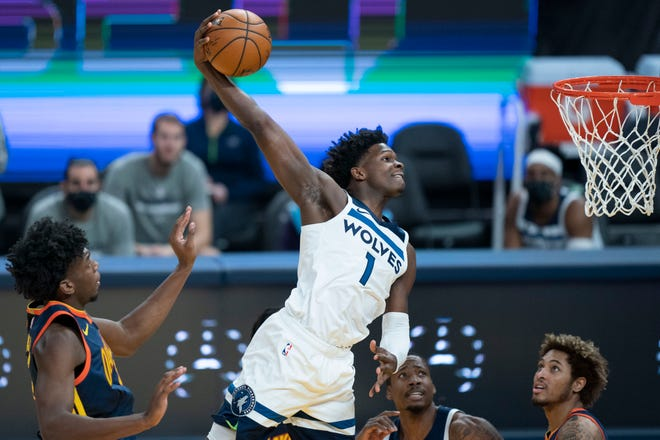 January 25, 2021; San Francisco, California, USA; Minnesota Timberwolves guard Anthony Edwards (1) dunks the basketball against Golden State Warriors center James Wiseman (33) during the first quarter at Chase Center. Mandatory Credit: Kyle Terada-USA TODAY Sports