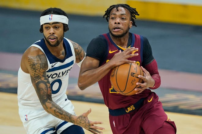 Cavaliers guard Darius Garland had 19 points and 11 assists in a 100-98 win over the Minnesota Timberwolves on Monday night at Rocket Mortgage FieldHouse. [Tony Dejak/Associated Press]