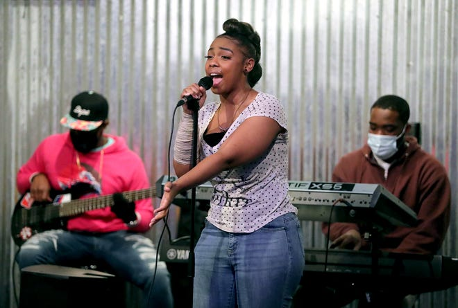 Brooke Jai rehearses with the house band at Charise Bryant's My World Studios in Coventry Township.