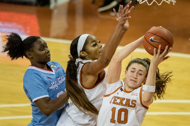 Texas guard Shay Holle (10) grabs a rebound over teammate Charli Collier (35) during a win over Louisiana Tech in Austin on Dec. 2, 2020.
